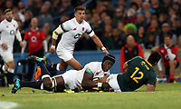 Maro Itoje of England looks to tackle Damian de Allende of South Africa during the 2018 Castle Lager Incoming Series 2nd Test match between South Africa and England at the Toyota Stadium.Bloemfontein,South Africa. 16,06,2018 Photo by Steve Haag / stevehaagsports.com