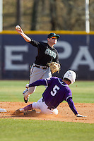 Connor Owings (6) of the Coastal Carolina Chanticleers turns a double play as Kyle Brandenburg (5) of the High Point Panthers slides into second base at Willard Stadium on March 15, 2014 in High Point, North Carolina.  The Chanticleers defeated the Panthers 1-0 in game one of a double-header.  (Brian Westerholt/Four Seam Images)