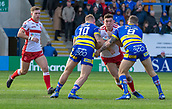 9th February 2019, Halliwell Jones Stadium, Warrington, England; Betfred Super League rugby, Warrington Wolves versus Hull KR; Robbie Mulhern  is tackled by Mike Cooper and Daryl Clark