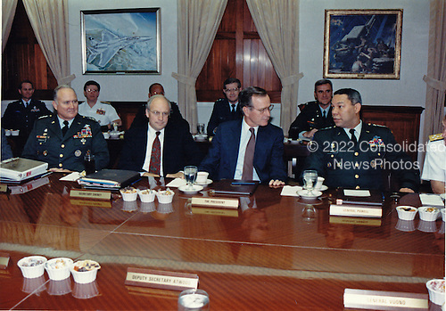A briefing at the Pentagon in Washington, D.C. on Wednesday, August 15, 1990 on the state of United States military deployments to Saudi Arabia in response to the Iraqi invasion of Kuwait.  Pictured from left to right: General H. Norman Schwarzkopf, U.S. Army, Commander-in-Chief, U.S. Central Command (CENTCOM), and the man holding command authority for Operation Desert Shield -- the deployment of U.S. military forces to Saudi Arabia; U.S. Secretary of Defense Dick Cheney; U.S. President George H.W. Bush; and Chairman, Joint Chiefs of Staff, General Colin E. Powell, U.S. Army.  Schwarzkopf passed away in Tampa, Florida on Thursday, December 27, 2012..Mandatory Credit: Robert D. Ward / DoD via CNP