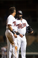Salt River Rafters manager Tommy Watkins (8) talks to left fielder Jaylin Davis (30), both of the Minnesota Twins organization, between innings of an Arizona Fall League game against the Scottsdale Scorpions at Salt River Fields at Talking Stick on October 11, 2018 in Scottsdale, Arizona. Salt River defeated Scottsdale 7-6. (Zachary Lucy/Four Seam Images)