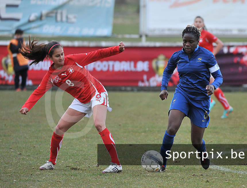 Switzerland U19 - France U19 : Swiss Aline Stöckli in a duel with French Griedge M'Bock Bathy (C) (right).foto DAVID CATRY / Nikonpro.be