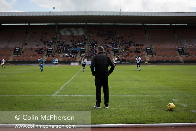 Edinburgh City striker manager Gary Jardine watching the first-half action from the touchline opposite the grandstand at Meadowbank. Despite taking the lead in the 66th minute through Ousman See's goal, City lost the game 2-1, watched by a crowd of 410 and remained without a point at the foot of the table after four League games.