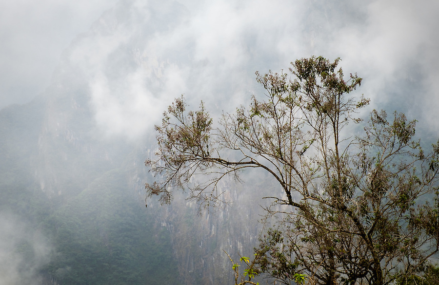 MACHU PICCHU, PERU - CIRCA OCTOBER 2015:  Fog rolling over Machu Picchu in Peru,