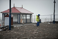 Monday 06 January 2014<br /> Pictured: Police and officials clear the promenade asThe Sea batters Aberystwyth Seafront<br /> Re: Storm force winds and high tides hit the UK