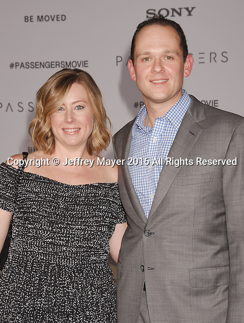 WESTWOOD, CA - DECEMBER 14: Producer Michael Maher (R) and guest arrive at the Premiere Of Columbia Pictures' 'Passengers' at Regency Village Theatre on December 14, 2016 in Westwood, California.