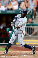 Rey Navarro (8) of the Northwest Arkansas Naturals makes contact on a pitch during a game against the Springfield Cardinals and the Springfield Cardinals at Hammons Field on July 30, 2011 in Springfield, Missouri. Springfield defeated Northwest Arkansas 11-5. (David Welker / Four Seam Images)