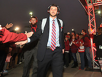 NWA Media/Michael Woods --12/29/2014-- w @NWAMICHAELW...University of Arkansas quarterback Brandon Allen is greeted by fans as the Razorbacks arrives to NRG Stadium in Houston as they get ready to play in the Texas Bowl.