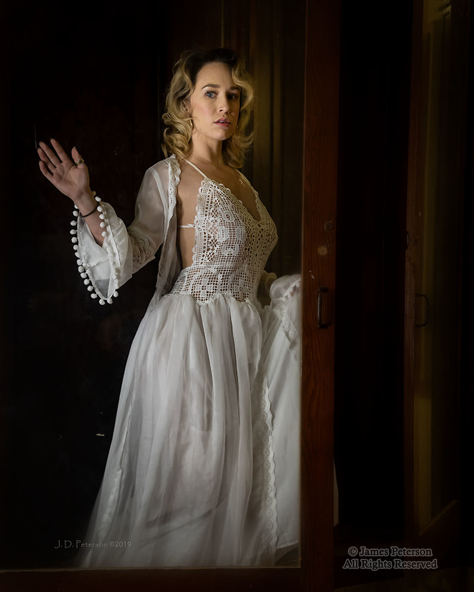 Restless Night #2 ©2019 James D. Peterson.  In the historic Jerome High School, the beautiful model Cora Malone finds a fine setting for a bit of drama in Arizona's most populous ghost town.
