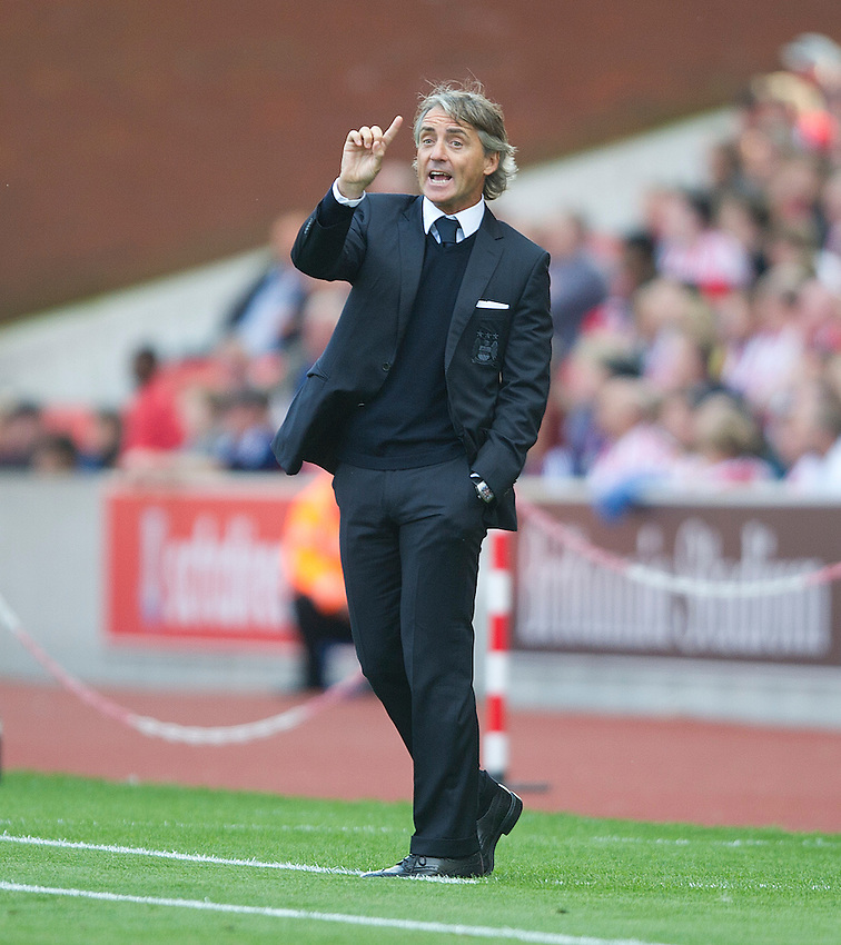 Manchester City's Manager Roberto Mancini makes a point to his players..Football - Barclays Premiership - Stoke City v Manchester City - Saturday 15th September 2012 - Britannia Stadium - Stoke..