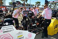 Oct. 27, 2012; Las Vegas, NV, USA: NHRA crew members for top fuel driver Antron Brown during qualifying for the Big O Tires Nationals at The Strip in Las Vegas. Mandatory Credit: Mark J. Rebilas-