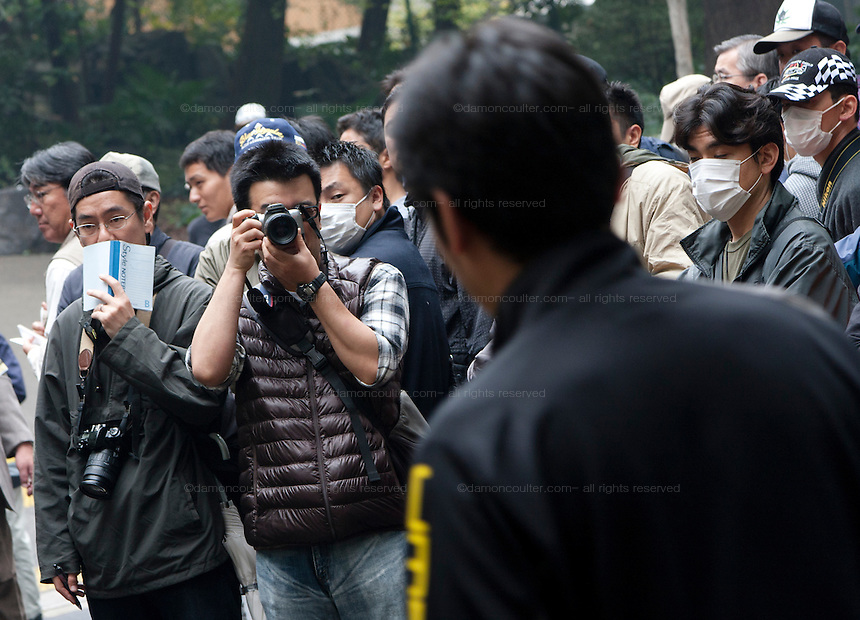 Security police record and photographer unionists and activists at a Demo by left wing groups in Hibiya Park, Tokyo, Japan Sunday November 6th 2011