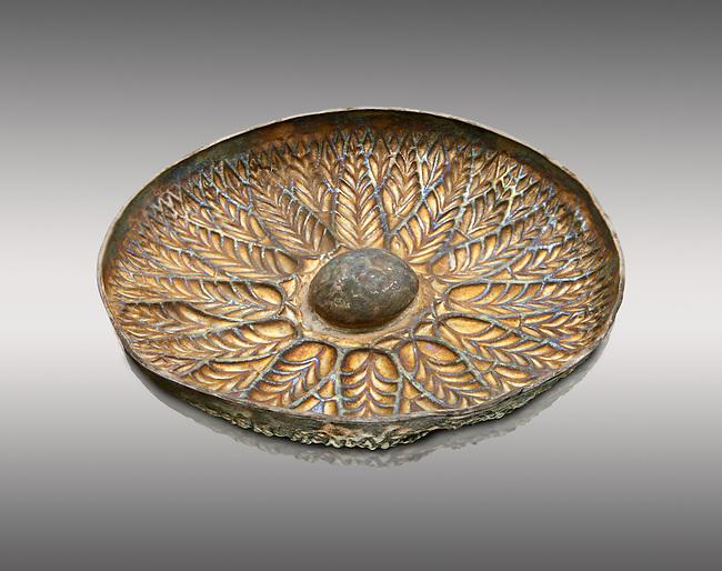 Etruscan embossed silver phiale or patera, or wine drinking bowl, end of 4th century B.C. inv 132265,  National Archaeological Museum Florence, Italy , against grey