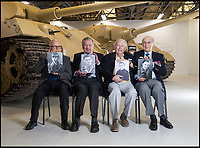 BNPS.co.uk (01202 558833)<br /> Pic: PhilYeomans/BNPS<br /> <br /> (L to R) Waldemar Pliska, Ernest Slarks, Wilhelm Fischer and Ken Tout.<br /> <br /> This is the poignant moment two German Tiger tank drivers and their British counterparts met for the first time 72 years after they fought on opposite sides in the Second World War.<br /> <br /> Wilhelm Fischer and Waldemar Pliska helped instill terror in British troops by manning the fearsome fighting machines and unleashing hell with their huge 88mm guns.<br /> <br /> Two of the enemy with first hand experiences of the heavily armoured Tigers were British tank men Ernest Slarks and Dr Ken Tout.<br /> <br /> Now aged in their 90s the four old foes became friends when they assembled for the launch of an historic exhibition at the Tank Museum in Bovington, Dorset.