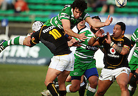 Manawatu captain Nick Crosswell loses the ball in the tackle of Dan Kirkpatrick as Anthony Perenise (right) looks on during the Air NZ Cup preseason match between Manawatu Turbos and Wellington Lions at FMG Stadium, Palmerston North, New Zealand on Friday, 17 July 2009. Photo: Dave Lintott / lintottphoto.co.nz