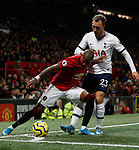 Manchester United's Ashley Young (L) battles for the ball with Tottenham Hotspur's Christian Eriksen during the Premier League match at Old Trafford, Manchester. Picture date: 4th December 2019. Picture credit should read: Darren Staples/Sportimage