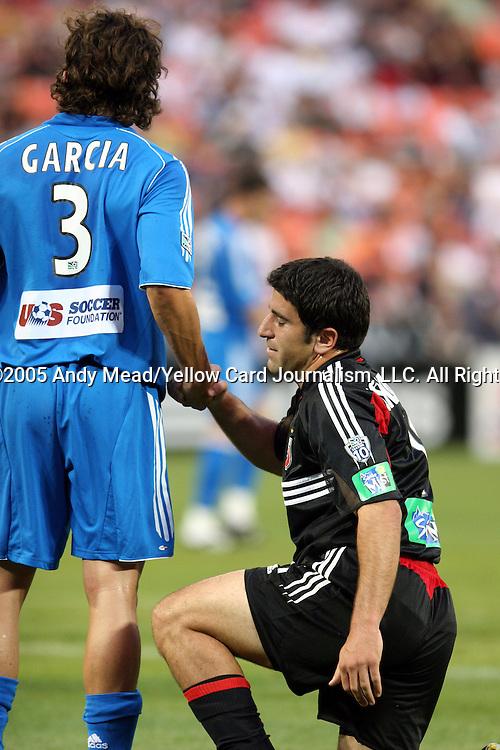 21 May 2005: Nick Garcia (3) helps Alecko Eskandarian (right) to his feet. DC United defeated the Kansas City Wizards 3-2 at RFK Stadium in Washington, DC in a regular season Major League Soccer game. . .