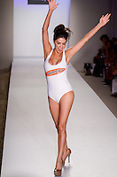 Real Housewives of Miami, Adriana De Moura, walks runway at A.Z Araujo Swimwear Show during Mercedes Benz IMG Fashion Swim Week 2013 at The Raleigh Hotel, Miami Beach, FL on July 23, 2012