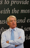 Charles Schwab(cq), the founder and chief executive officer of the Charles Schwab Corporation, talks to employees at the downtown Denver office in Colo., Wednesday, July 13, 2005. The company, which was founded in 1971, serves over 7 million investors...PHOTOS/ MATT NAGER