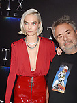 LAS VEGAS, NV - MARCH 28: Actress Cara Delevingne (L) and writer/director Luc Besson at CinemaCon 2017 The State of the Industry: Past, Present and Future and STXfilms Presentation at The Colosseum at Caesars Palace during CinemaCon, the official convention of the National Association of Theatre Owners, on March 28, 2017 in Las Vegas, Nevada.