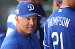 Manager Dave Roberts works the dugout before a spring training game between the Los Angeles Dodgers and the Texas Rangers in Surprise, Ariz., on Saturday, March 26, 2017.<br /> Photo by Cathleen Allison/Nevada Photo Source