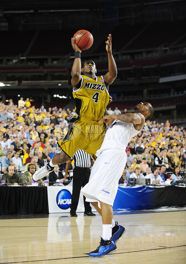 Mar 26, 2009; Glendale, AZ, USA; Missouri Tigers guard (4) J.T. Tiller shoots a basket in the first half against the Memphis Tigers during the west regional semifinals of the 2009 NCAA mens basketball tournament at the University of Phoenix Stadium. Mandatory Credit: Mark J. Rebilas-