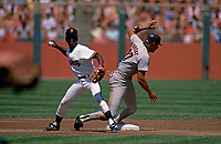 SAN FRANCISCO, CA:  Jose Uribe of the San Francisco Giants turns a double play at second base, forcing out San Diego Padres base runner Mark Parent during their game  at Candlestick Park in San Francisco, California in 1987. (Photo by Brad Mangin)