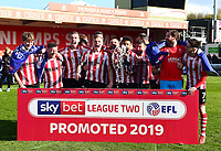 Lincoln City players celebrate promtion at the end of the game<br /> <br /> Photographer Andrew Vaughan/CameraSport<br /> <br /> The EFL Sky Bet League Two - Lincoln City v Cheltenham Town - Saturday 13th April 2019 - Sincil Bank - Lincoln<br /> <br /> World Copyright © 2019 CameraSport. All rights reserved. 43 Linden Ave. Countesthorpe. Leicester. England. LE8 5PG - Tel: +44 (0) 116 277 4147 - admin@camerasport.com - www.camerasport.com