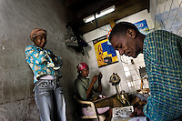 "A Cuban man reads a comic book while sitting in a shoe repair workshop in Alamar, a huge public housing complex in the Eastern Havana, Cuba, 5 February 2009. The Cuban economic transformation (after the revolution in 1959) has changed the housing status in Cuba from a consumer commodity into a social right. In 1970s, to overcome the serious housing shortage, the Cuban state took over the Soviet Union concept of social housing. Using prefabricated panel factories, donated to Cuba by Soviets, huge public housing complexes have risen in the outskirts of Cuban towns. Although these mass housing settlements provided habitation to many families, they often lack infrastructure, culture, shops, services and well-maintained public spaces. Many local residents have no feeling of belonging and inspite of living on a tropical island, they claim to be ""living in Siberia""."