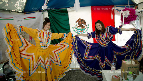 """May 5, 2013, Tokyo, Japan - Two girls wear Mexican costumes at """"Cinco de Mayo"""" festival in Tokyo. """"Cinco de Mayo"""" festival was held in Japan for the first time to celebrate all of the Americas from May 3 to 4 at Yoyogi Park. This is originally one of the biggest Latin festival in USA. (Photo by Rodrigo Reyes Marin/AFLO)"""
