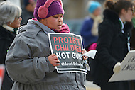 January 26, 2013  (Washington, DC)  A woman holds a sign as she walks along Constitution Ave. for the March on Washington for Gun Control.  (Photo by Don Baxter/Media Images International)