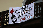 World Economic Forum - WEF - Davos 2018. <br /> Banners reading - Global Warming With Fire & Fury hang from a house while U.S President Donald J. Trump is protested against country-wide during the 48th World Economic Forum in Davos, Switzerland on January 26, 2018.<br /> Pictured: