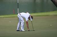 Joost Luiten (NED) repairs his pitch mark on the 18th green during Sunday's Final Round of the rain shortened 2011 Barclays Singapore Open, Singapore, 13th November 2011 (Photo Eoin Clarke/www.golffile.ie)