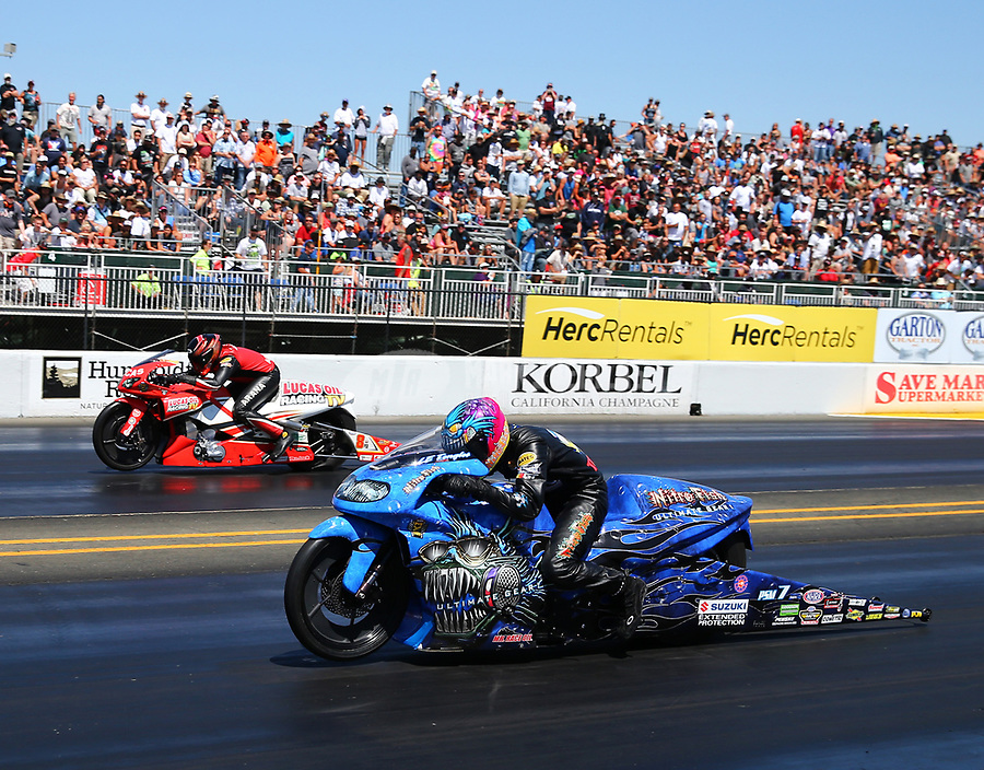 Jul 30, 2017; Sonoma, CA, USA; NHRA pro stock motorcycle rider L.E. Tonglet (near) races alongside Hector Arana Jr during the Sonoma Nationals at Sonoma Raceway. Mandatory Credit: Mark J. Rebilas-USA TODAY Sports