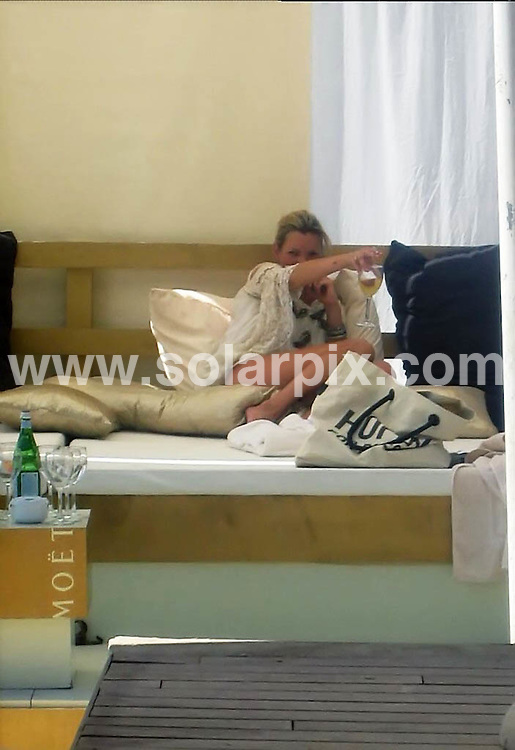 **ALL ROUND EXCLUSIVE PICTURES FROM SOLARPIX.COM**.**WORDLWIDE SYNDICATION RIGHTS EXCEPT FOR SPAIN** NO PUBLICATION IN SPAIN**.Kate Moss and daughter Lila Grace met up with Sylvester Stallone and Philip Green for lunch in a beach bar in Ibiza. The trio drank Champagne while Stallone chewed on a large Cuban cigar..JOB REF:   6960      PTB        DATE: 03.08.08.**MUST CREDIT SOLARPIX.COM / POOL PRESS OR DOUBLE FEE WILL BE CHARGED* *UNDER NO CIRCUMSTANCES IS THIS IMAGE TO BE REPRODUCED FOR ANY ONLINE EDITION WITHOUT PRIOR PERMISSION*