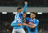 Vlad Chireches celebrates with Lorenzo Insigne  and David Lopez  after scoring during the  italian serie a soccer match,between SSC Napoli and Chievo Verona      at  the San  Paolo   stadium in Naples  Italy , March 05, 2016