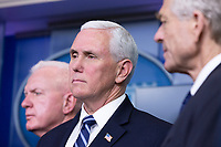 United States Vice President Mike Pence listens during a news conference on the Coronavirus crisis in the Brady Press Briefing Room of the White House in Washington, DC on Saturday, March 21, 2020.  Credit: Stefani Reynolds / Pool via CNP/AdMedia