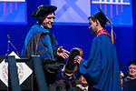 Omar Ortiz right, receives the Dean's Outstanding Senior Award from Ray Whittington, dean of the Driehaus College of Business, Sunday, June 11, 2017, during the DePaul University Driehaus College of Business commencement ceremony at the Allstate Arena in Rosemont, IL. (DePaul University/Jamie Moncrief)
