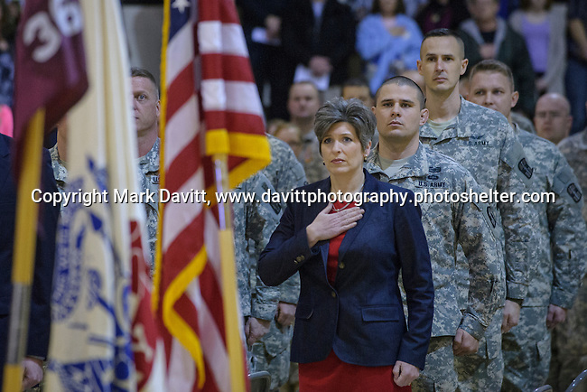 Iowa Senator Joni Ernst attended the Deployment Farewell Ceremony for the Iowa National Guard 361st Medical Logistics Company held Saturday at the Southeast Polk's Spring Creek Elementary gym. Eric Morrow, directly behind Ernst, is SEP's Junior Varsity wrestling coach, serves with the 361st. http://tinyurl.com/lfkjfrh