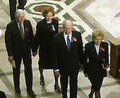 Former United States President Jimmy Carter and former first lady Rosalyn Carter and former United States President Gerald R. Ford and former first lady Betty Ford depart the Washington National Cathedral  following  the National Day of Prayer Service in Washington, D.C. on Friday, September 14, 2001.