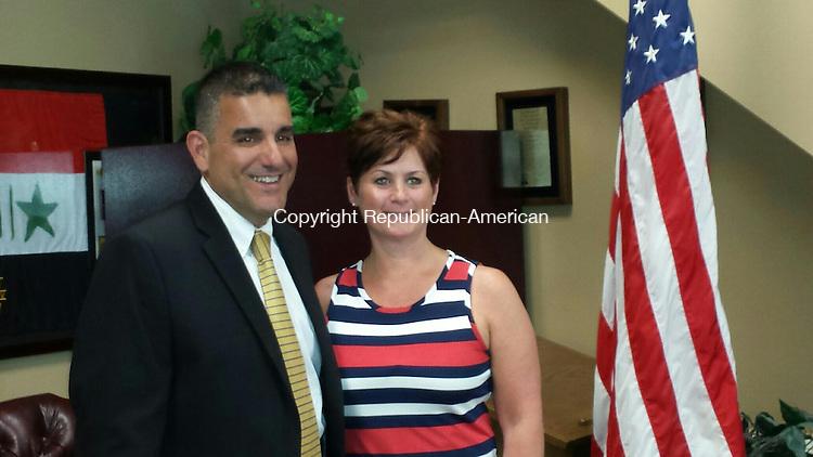 MIDDLEBURY, CT -- 31 June 2014: 063114BB02 --- Police Chief James Viadero with his wife Kim. Bill Bittar Republica-American