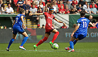 Portland, OR - Sunday, May 29, 2016: Portland Thorns FC forward Nadia Nadim (9) is marked by Seattle Reign FC defender Lauren Barnes (3) and midfielder Keelin Winters (11) during a regular season National Women's Soccer League (NWSL) match at Providence Park.