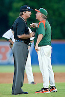 June 12, 2010:     Miami head coach Jim Morris argues with second base umpire Phil Benson over a disputed play at second base in the 5th inning during game two of NCAA Gainesville Super Regional action between the University of Florida Gators and Miami Hurricanes at Alfred A. McKethan Stadium on the campus of University of Florida in Gainesville.   Florida defeated Miami in 10 innings 4-3 to advance to the College World Series in Omaha, Nebraska...........
