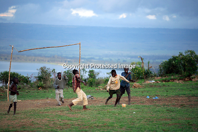 Children play soccer close to Lake Naivasha. Many people here work in the flower houses and the live in overcrowded dirty conditions. These flowers are exported internationally. Photo: Per-Anders Pettersson/Getty Images