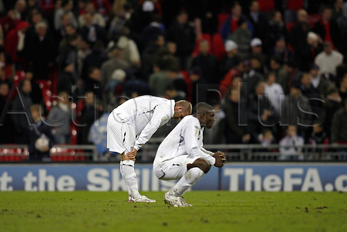 21 November 2007: David Beckham and Micah Richards show their disappointment in failing to qualify for the European Championships after losing the qualifier between England and Croatia played at Wembley. Croatia won the game 3-2. Photo: Glyn Kirk/Actionplus....071121 football soccer player loser lose