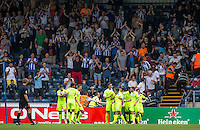Sammie Szmodics (10) of Colchester United celebrates his goal in front of the Colchester United fans with teammates during the Sky Bet League 2 match between Wycombe Wanderers and Colchester United at Adams Park, High Wycombe, England on 27 August 2016. Photo by Liam McAvoy.