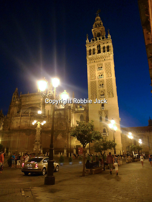 Cathedral of Saint Mary of the See and La Giralda in Seville. It is the largest gothic cathedral in the world. It occupies the site of Hagia Sophia, a mosque built by the Almohads in the late 12th century. La Giralda, its bell tower, is a legacy from the Moorish structure.