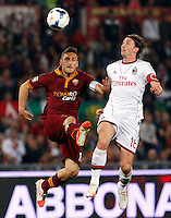 Calcio, Serie A: Roma vs Milan. Roma, stadio Olimpico, 25 aprile 2014.<br /> AS Roma forward Francesco Totti, left, and AC Milan midfielder Riccardo Montolivo jump for the ball during the Italian Serie A football match between AS Roma and AC Milan at Rome's Olympic stadium, 25 April 2014.<br /> UPDATE IMAGES PRESS/Riccardo De Luca