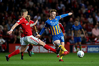 Jon Nolan of Shrewsbury Town passes the ball as Charlton's Patrick Bauer makes a challenge during Charlton Athletic vs Shrewsbury Town, Sky Bet EFL League 1 Play-Off Football at The Valley on 10th May 2018