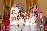 Children from Scoil Bhre?anain making their First Holy Communion in Portmagee Church on Saturday were front l-r; Clodagh Coffey, Ardan O'Connor, Ri?ona Moran, Arron O'Connor, back l-r; Olivia O'Shea, Fionain Hussey, Stephen Keating & Charlotte Hulme with Fr Hussey and Laura Nugent(Teacher).